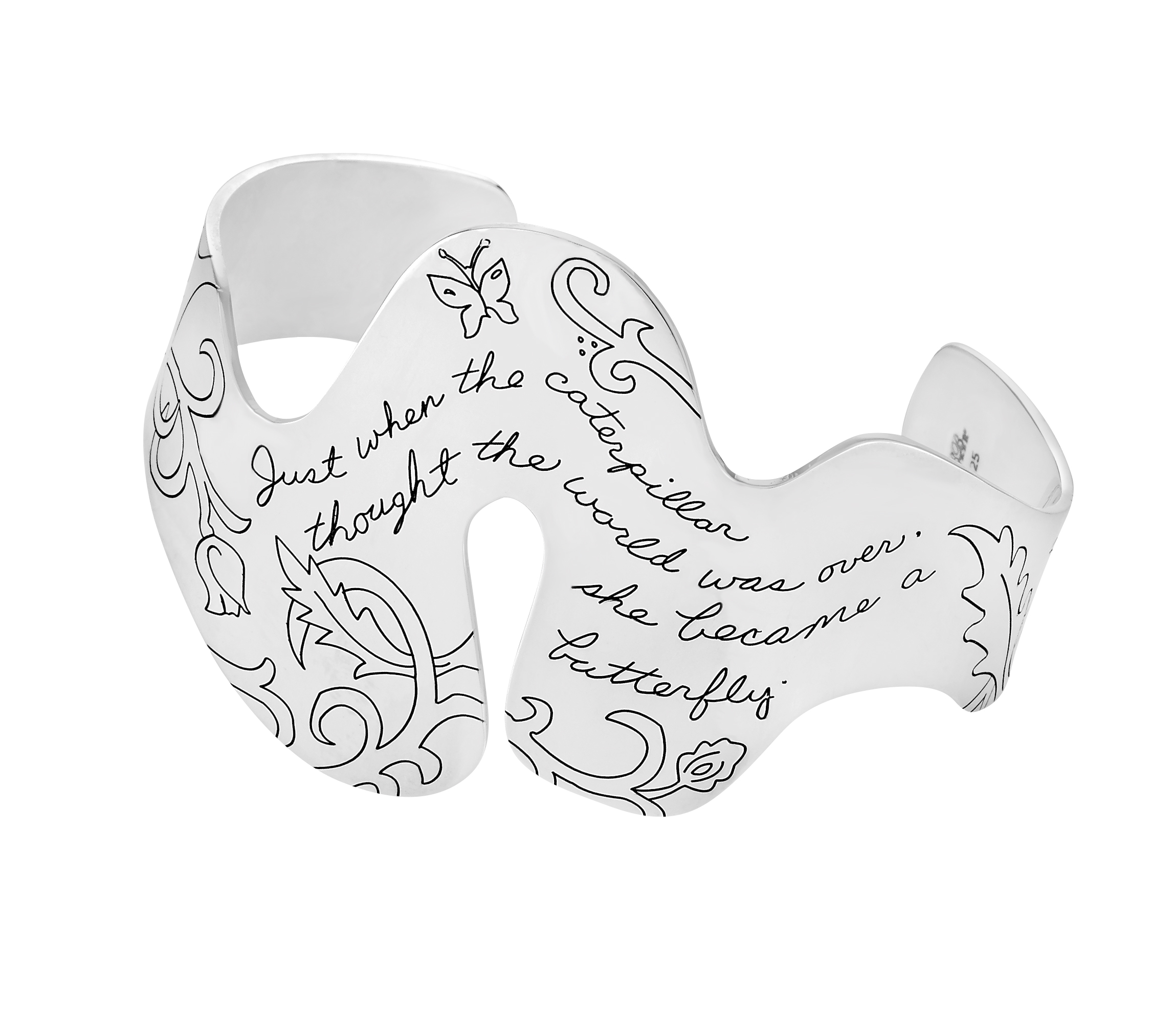 """Engraved floral motif adorns substantial sterling cuff with several uniquely shaped curves suggesting the flow of change.  """"Just when the caterpillar thought the world was over, she became a butterfly."""""""