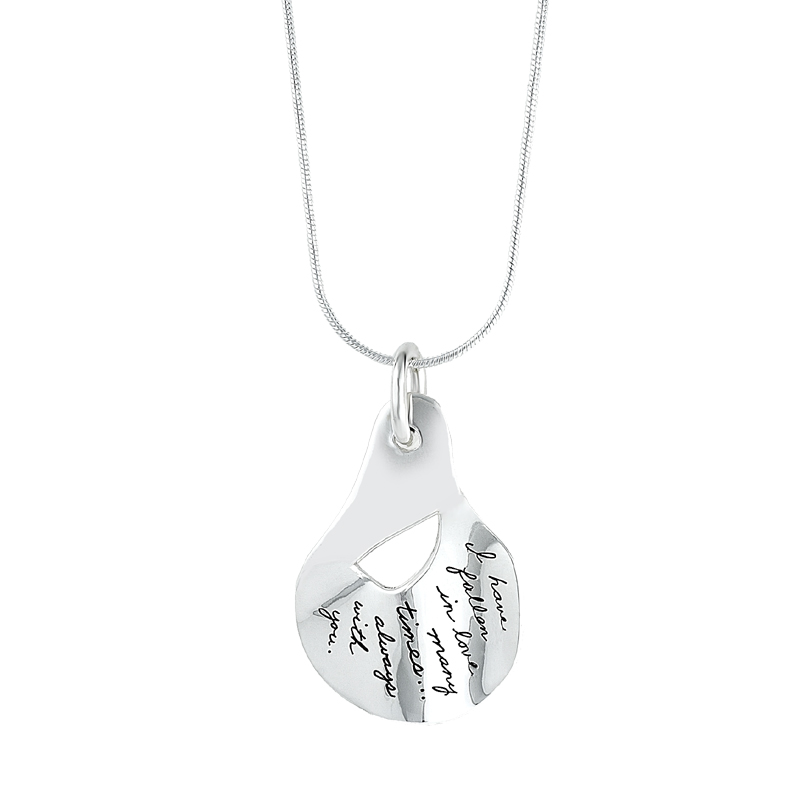 Sterling silver pendant in the shape of a raindrop with irregular half circle cutout near top center. Engraved quote reads: I have fallen in love many times... Always with you.