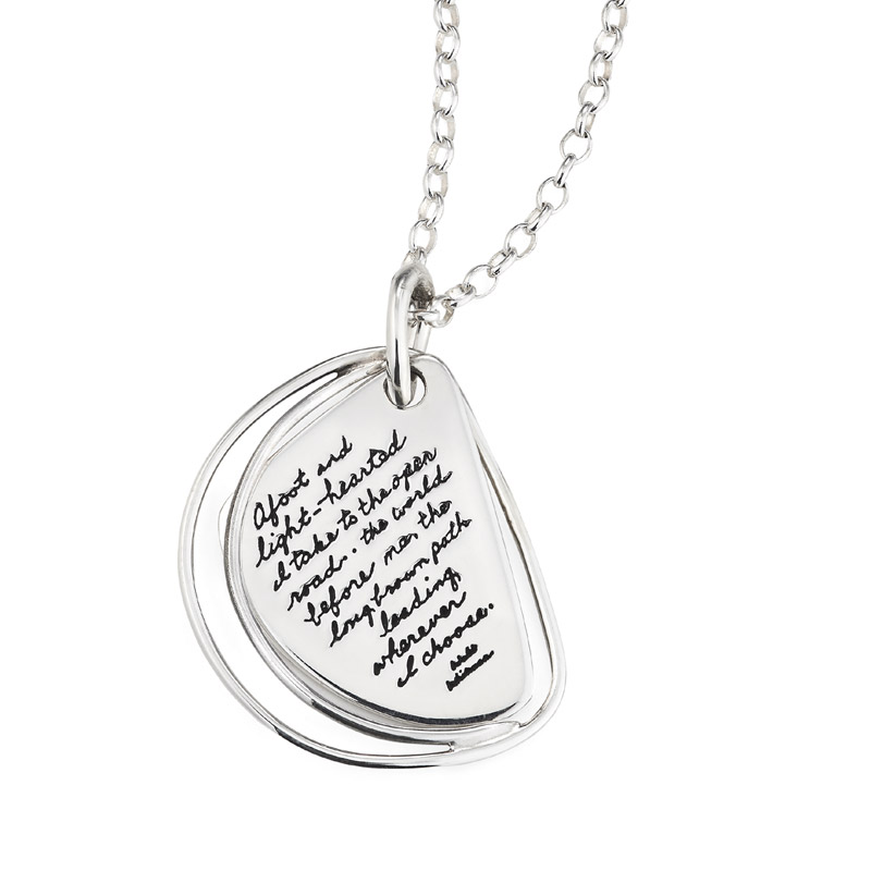 The open road sterling silver wedged shaped plaque with two separate wires on one side. Engraved quote reads: Afoot and light-hearted I take to the open road...the world before me, the long brown path leading wherever I choose. -Walt Whitman