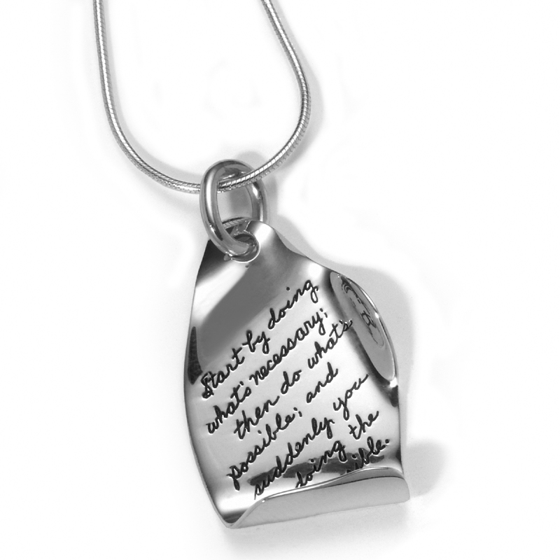 Irregular shaped inspirational sterling silver pendant with bottom curled up along with the right side bent up Engraved quote reads: Start by doing what's necessary; then do what's possible, and suddenly you are doing the impossible. St. Francis of Assis