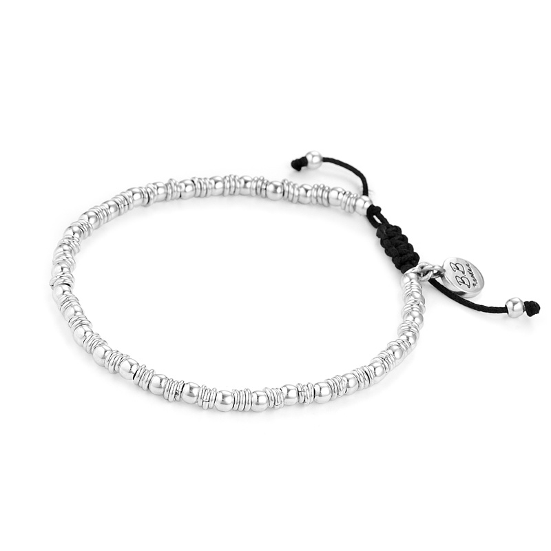 Bracelet of tiny silver beads professionally strung on a black adjustable cord is the perfect accent to wear with other BB Becker inspirational jewelry.