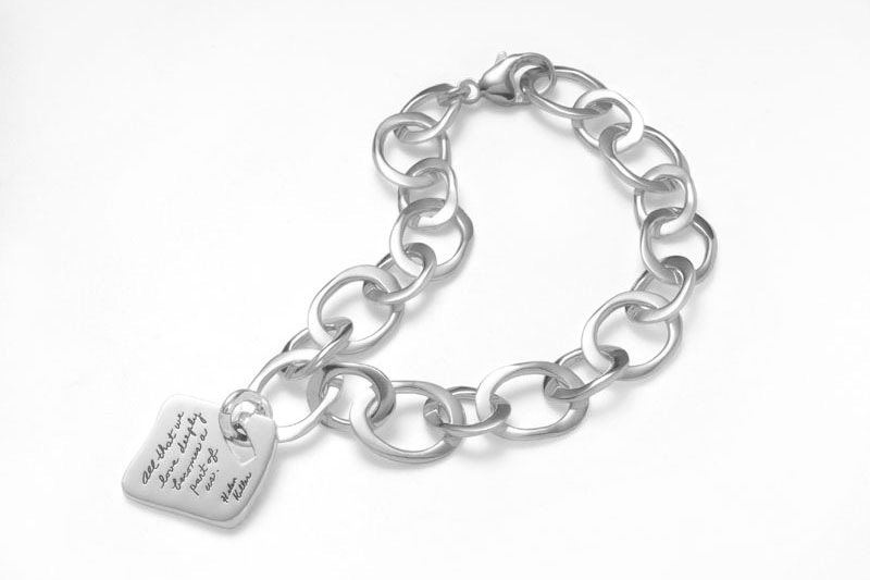 Handmade link bracelet and charm saying Helen Keller's inspirational words - All that we love deeply becomes a part of us.