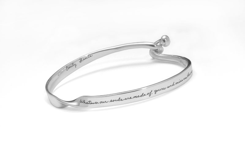 Emily Bronte's romantic quotation engraved on front and back of bracelet with two balls intertwined at closure says   Whatever our souls are made of, yours and mine are the same.