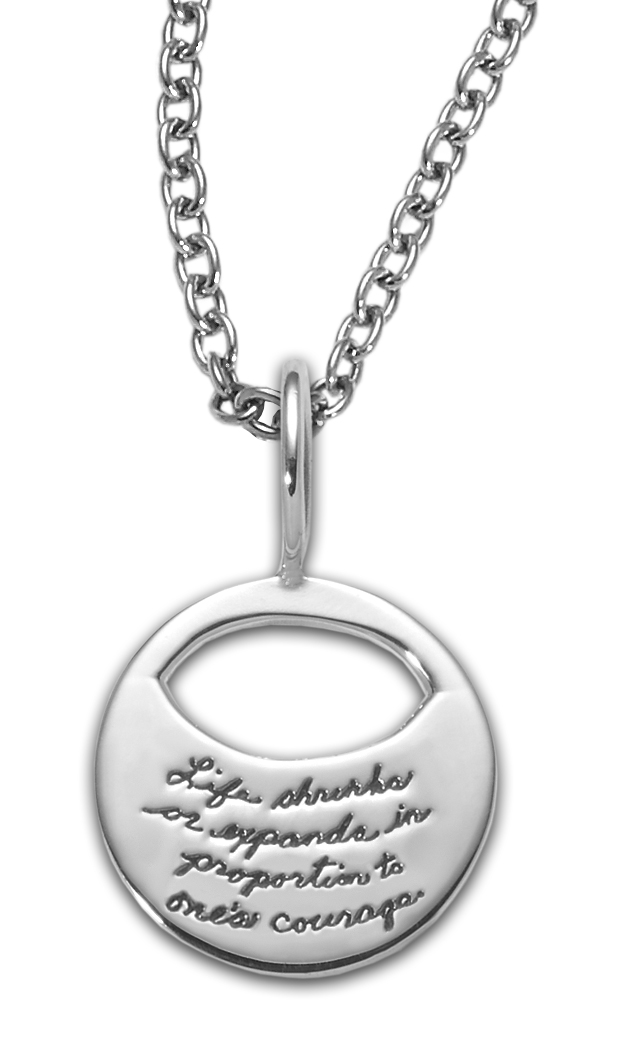 Sterling Silver Inspirational Circle Pendant an eye shaped cutout near the top the quote reads: Life shrinks or expands in proportion to one's courage. - Anais Nin