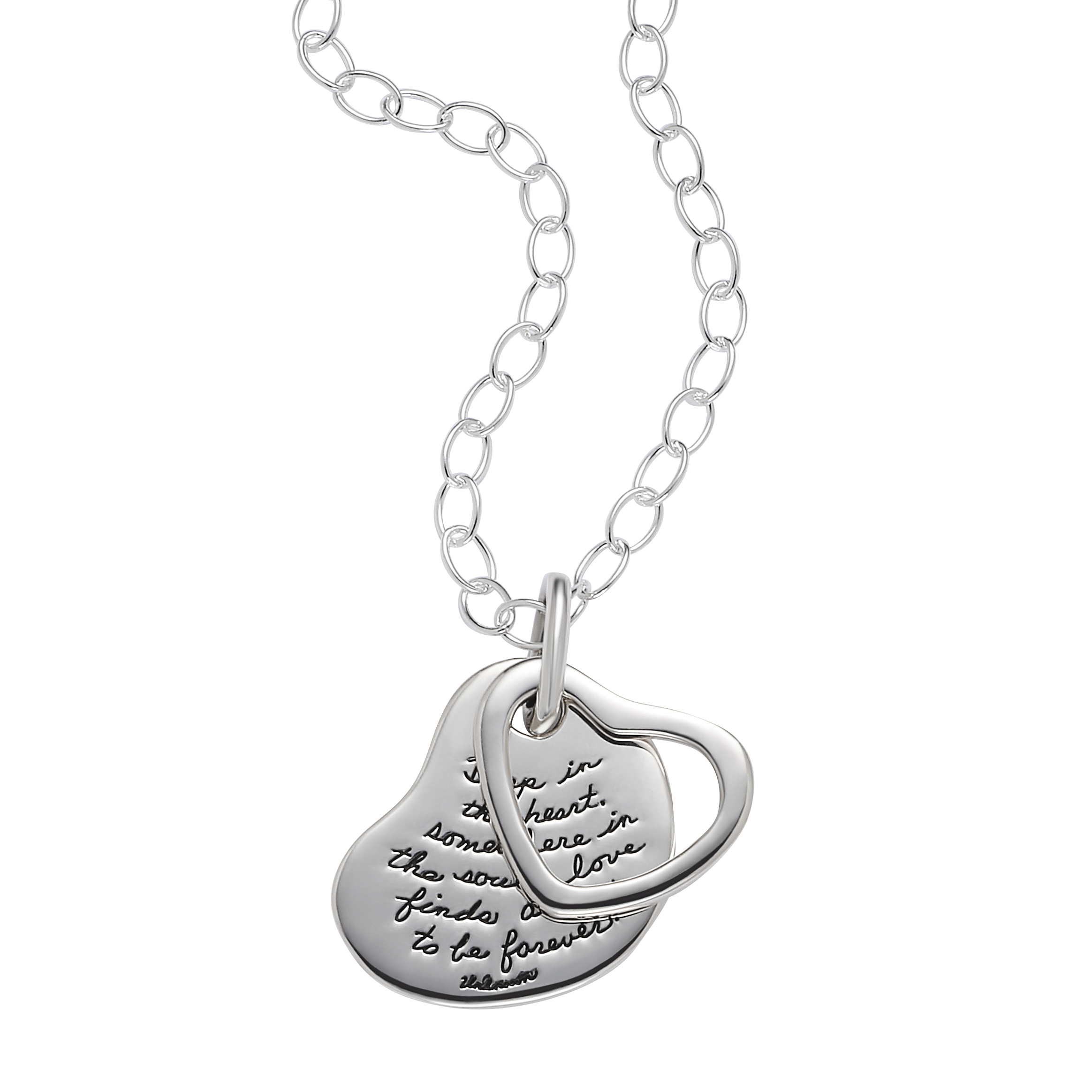 Sterling silver heart pendant with a smaller heart overlay with center cutout to show inscribed quote. Quote reads: Deep in the heart, somewhere in the soul, love finds a way to be forever.