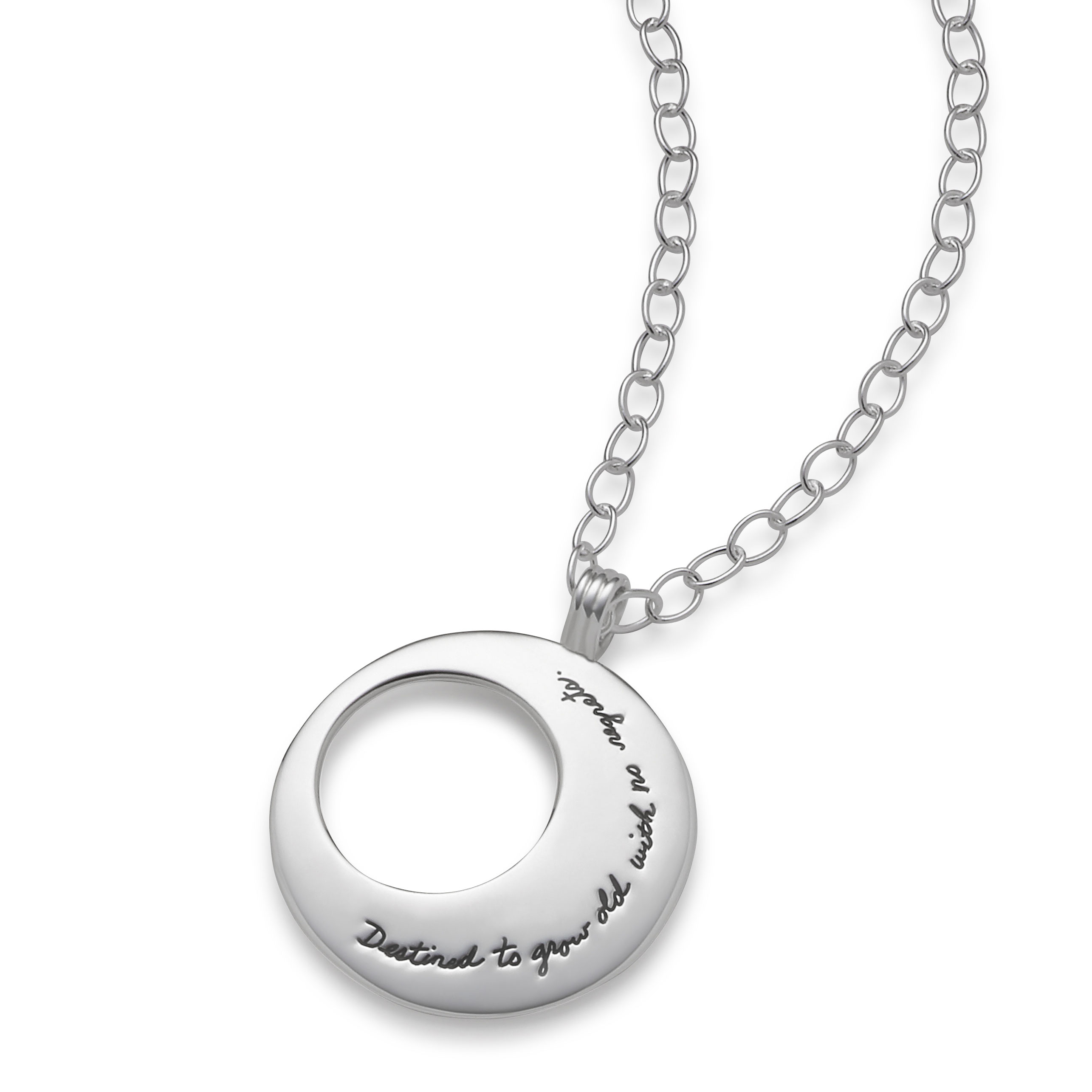 Inspirational eclipse necklace Circle shape with off center circle cutout on the left side. Quote on piece reads: Destined to grow old with no regrets.