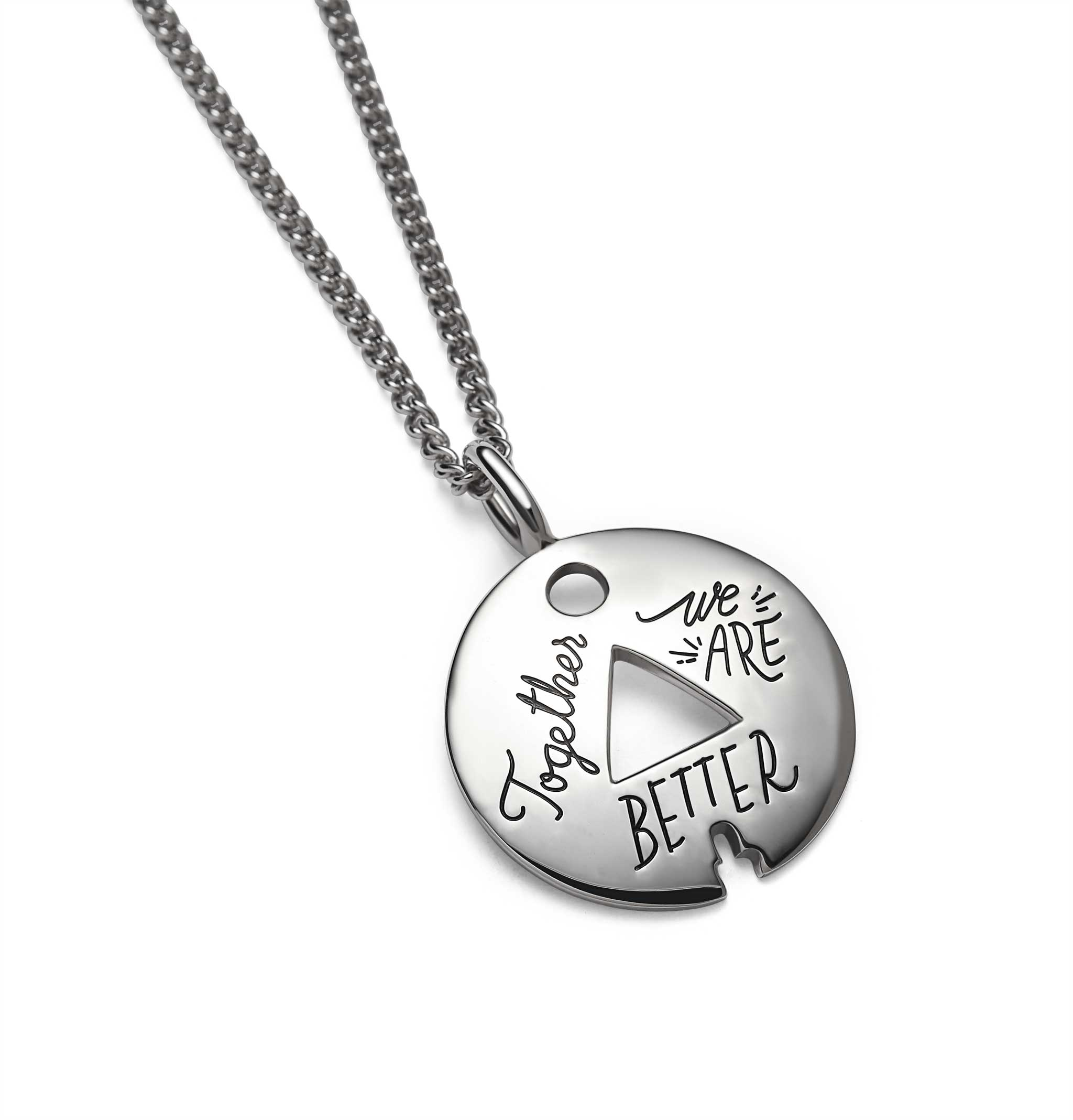 Circle Sterling silver token with triangle and small circle cutouts. Hand lettered message reads: Together we are better.