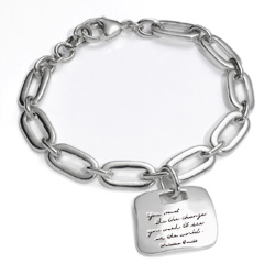 Gandhi quotation on silver amulet hanging from substantial oval link adjustable bracelet - You must be the change you wish to see in the world. - Gandhi's World