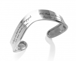 Open sterling silver cuff bracelet with engraved quote: What we have once enjoyed we can never lose. All that we love deeply becomes a part of us. ~Helen Keller