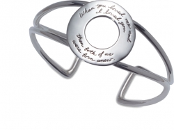 Large silver round plaque with words held by double silver wires spaced wide apart then touhing and wide again. Quotation - When you loved me and I loved you, both of us were born anew.