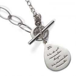 Sterling silver toggle necklace tear drop shaped plaque with a variety of links Inspirational message reads: We do not remember days. We remember moments. -Cesare Pavese