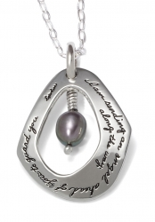 Inspirational tear drop sterling silver pendant with irregular shaped cutout in center. A suspended black pearl hangs and quote reads: I am sending an angel ahead of you to guide you along the way.