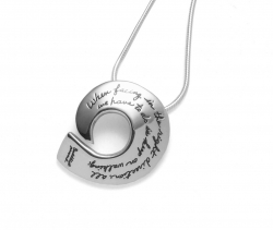 Sterling silver curl pendant with inspirational engraved quote: When facing in the right direction, all we have to do is keep on walking. -Buddhist Proverb