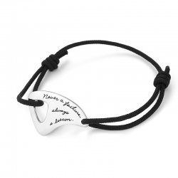 Black Corded Bracelet Maori tooth shaped plaque with an irregular cutout on the left side inspirational quote: Never a failure, always a lesson.