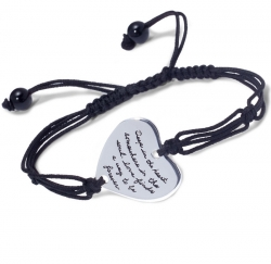 Sterling silver heart-shaped bracelet enhanced with fashionable corded loops, knots, and onyz beads carries engraved message:  Deep in the heart, somewhere in the soul, love finds a way to be forever.