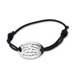 Black Wrist Cord Bracelet Oval shaped sterling silver plaque inscribed with the inspirational quote -There are no goodbyes for us. Wherever you are, you will always be in my heart. - Gandhi