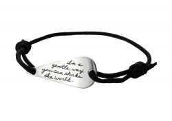 BB Becker Black Wrist Cord with Obelisk shaped Sterling Silver plaque engraved with inspirational quotation: In a gentle way you can shake the world.