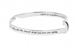 Famous literary quote from The Little Prince sits on a sterling bracelet with hook closure and artful twit of silver on opposite side:It is only with the heart that one can see rightly, what is essential is invisible to the eye-Antoine de Saint-Exupery