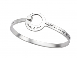 Silver bracelet in a band snaps into a circle opening with engraved words expressing importance of mother - Mother of Mine, bright star in my life, because of you I know what love is, when to hug, and how to shop.