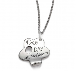 Sterling silver inspirational flower shaped necklace with quote: One day at a time.
