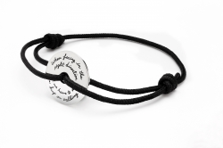 Black Corded Bracelet with Sterling Silver Inspirational round disc engraved quote reads: When facing in the right direction all we have to do is keep on walking.
